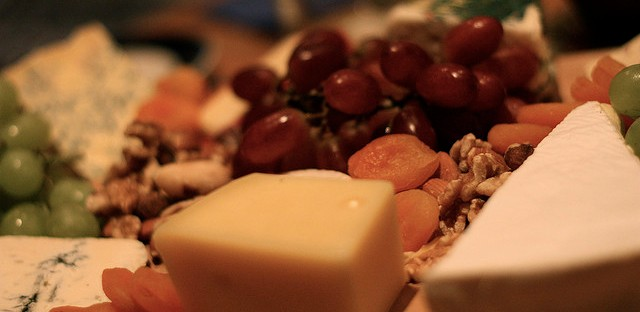 Cheese board grapes dried fruit hors d'ouvres