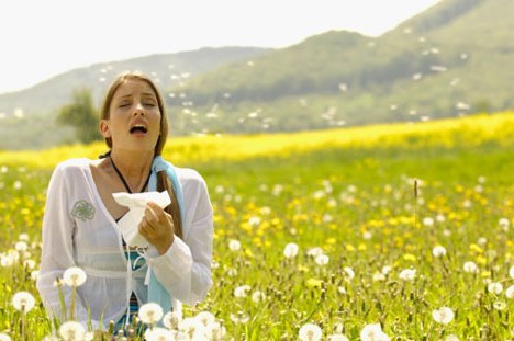 allergy season sneezing woman flower field