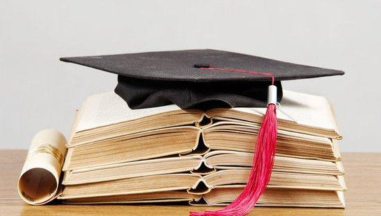 Graduation cap stack of books diploma