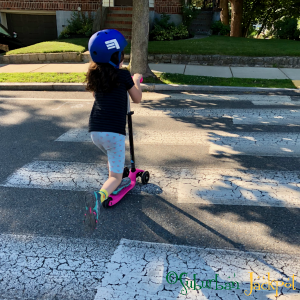 Girl scooter kindergarten suburbs