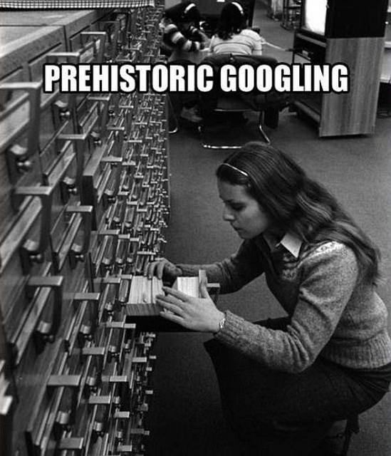 Woman searching card catalog history historical google