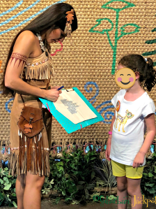 Pocahontas character greeting Disney Animal Kingdom Autograph banner