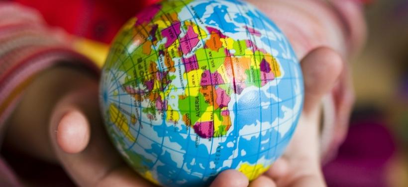 world globe hands holding travel