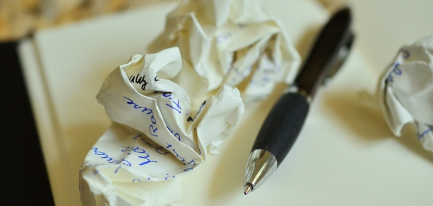 Notebook writing pen crumpled paper